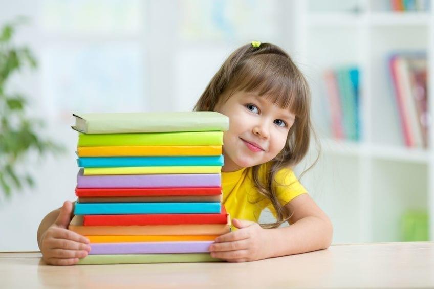 Smart kid girl preschooler with books