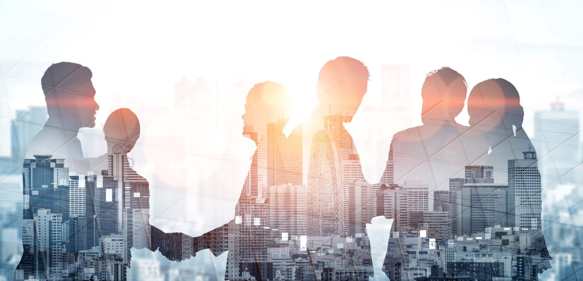 Double exposure image of many business people conference group meeting on city office building in background showing partnership success of business deal. Concept of teamwork, trust and agreement.